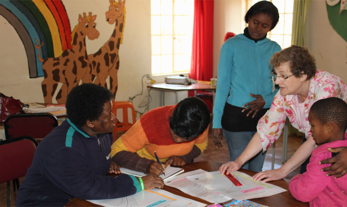 Noreen Oliver explaining CDC growth charts to care workers at Ledig OVC centre (South Africa)