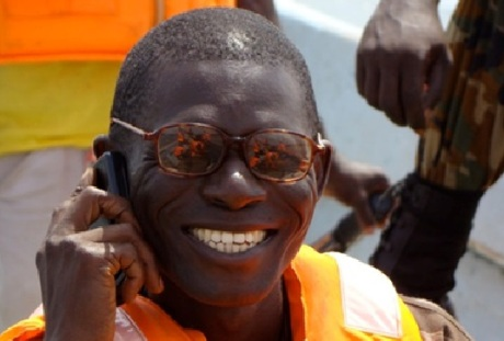 Joseph Musa, World Vision, with a mobile phone. Mobile phones are being used to improve healthcare for expectant and new mothers in Sierra Leone. Photo: Frédérique Vallieres
