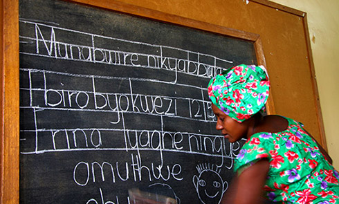 Edith teaching children in their local language at a school in Kabugho