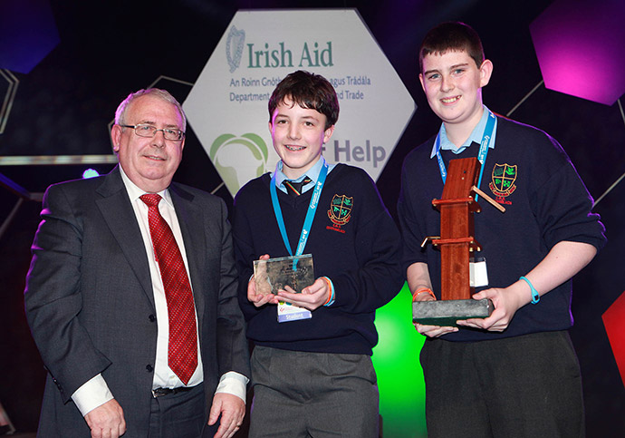 The winners of the Irish Aid/Self-Help Science for Development Award pictured with Minister Costello at the BT Young Scientist Tech Exhibition 2012: Keane Nolan and DJ Hanley of St Marys Academy CBS Carlow.